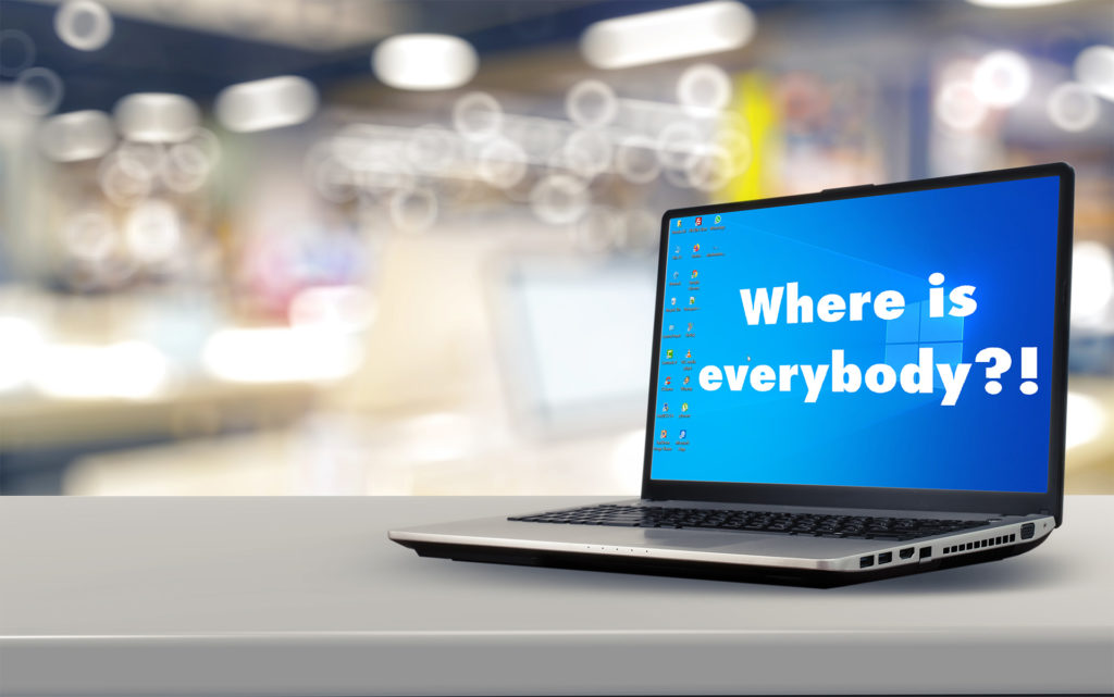 """Laptop on a desk with a Windows backdrop and the words """"Where is everybody?"""", representing """"world disorientation"""""""
